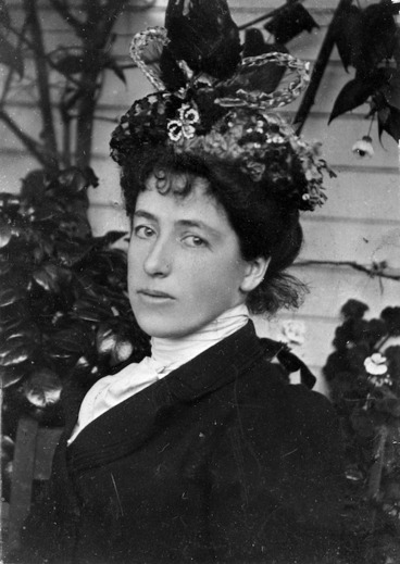 Image: Formal head and shoulders portrait of Frances Mary Hodgkins wearing an ornate hat