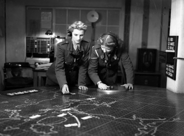 Image: Two members of the Women's Army Auxiliary Corps operating a plotting table
