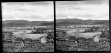Image: Man, sitting on a stump and looking out at fields and the settlement beyond, Catlins, Otago
