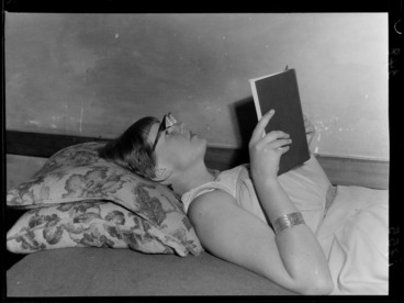 Image: An unidentified young woman models a new style of reading glasses