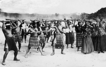 Image: Group of men and women doing a haka of welcome at Rotorua