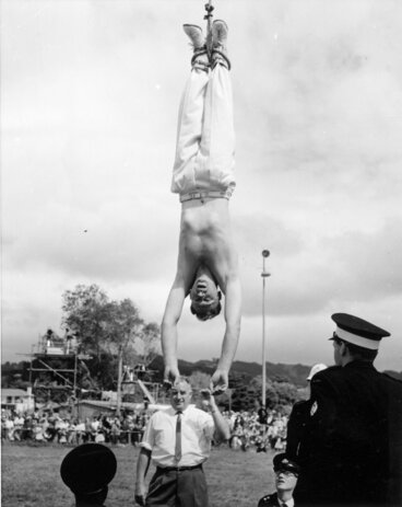 Image: Escapologist at A & P show, Trentham Park 6; lowered from crane.