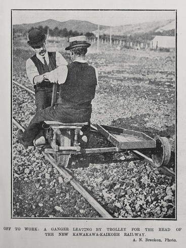 Image: OFF TO WORK: A GANGER LEAVING BY TROLLEY FOR THE HEAD OF THE NEW KAWAKAWA-KAIKOHE RAILWAY.