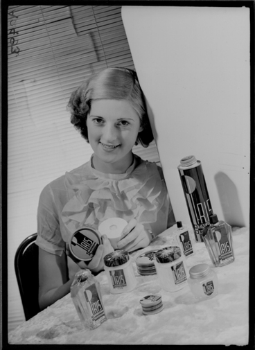 Image: 1/2 length portait of a model with Iris cosmetics for Sargood Son and Ewen 1940
