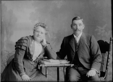 Image: 3/4 length family portrait of a man and a woman in the Snell....