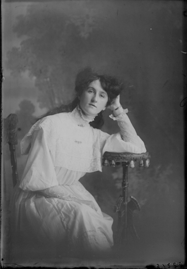 Image: 3/4 length portrait of Miss Kearney, sitting resting her elbow....