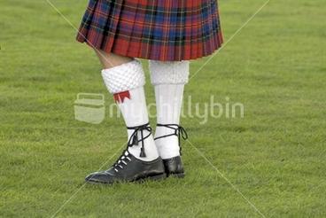 Image: Scotchman bottom half in a tartan kilt