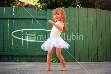 Image: Ella ballerina; does the barefoot hula, in her New Zealand backyard.