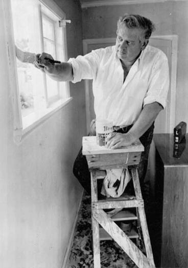 Image: Norman Kirk paints the house