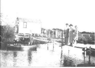 Image: Cottage & people beside Hokio Stream