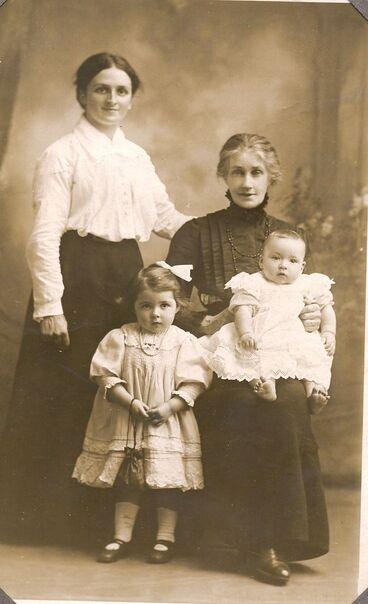 Image: Three generations - Group sitting of Mother, Daughter and Grandchildren. c1914-1918.