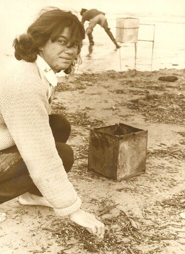 Image: Mona Williams sorts whitebait from rubbish in her catch, 1969