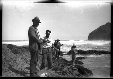 Image: Fishing from the rocks, O'Neills Bay, Bethells Beach.