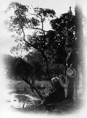Image: Charles Haigh and an older man on a river bank