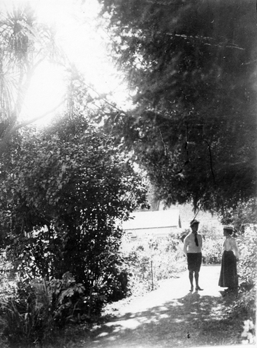 Image: A man and a woman standing in a garden