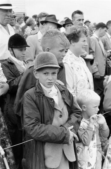 Image: Boy in equestrian outfit amongst the crowd at Kumeu A & P show