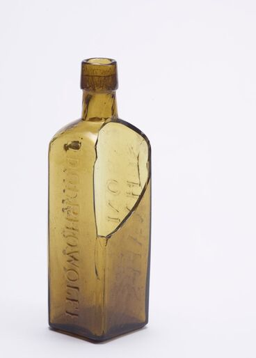 Image: Bottle - Yellow glass with 'Aromatic Schnapps'