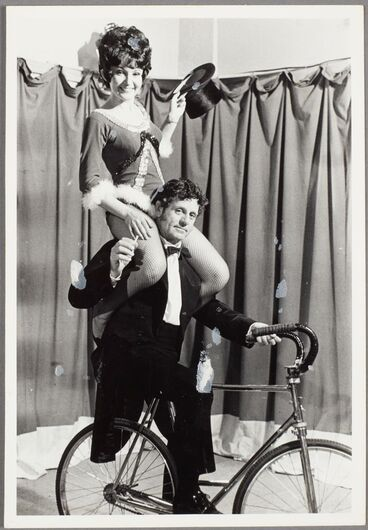 Image: Untitled [man on bike with woman on his shoulders]
