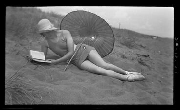 Image: Woman reading at beach