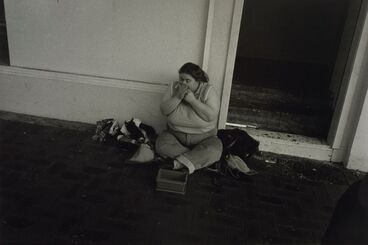 Image: Untitled, no.31 (woman sitting on street playing the harmonica). From the series: Public