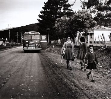 Image: They hear the school bus stop on the road. From the series: Washday at the pa