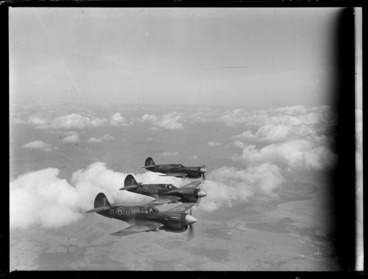 Image: Three Curtiss P-40 Kittyhawk aircraft in flight