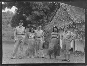 Image: Unidentified RNZAF men with two unidentified local girls in island costume, Rarotonga, Cook Islands