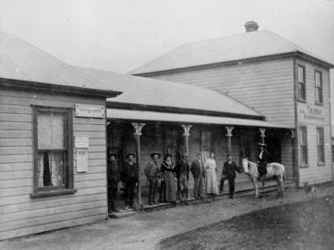 Image: Tainui Boarding House, Mokau, with a group on the verandah