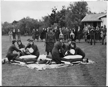 Image: Members of the ambulance section of the Manawatu Service Women's Auxillary Corps giving a demonstration in Milverton Park, Palmerston North during World War II