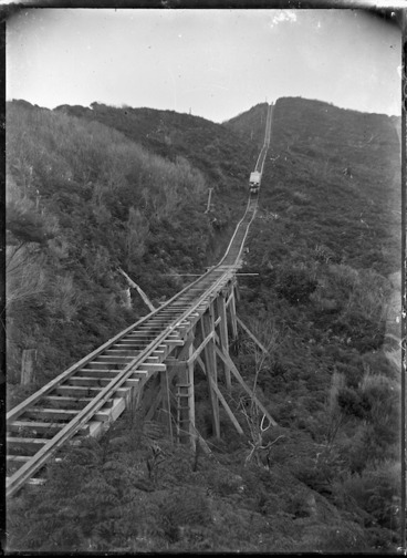Image: View of the top of the Karekare Incline, with a load of sawn timbers descending to Karekare.