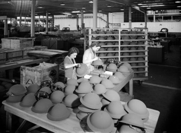 Image: Two unidentified women working on military helmets during World War 2