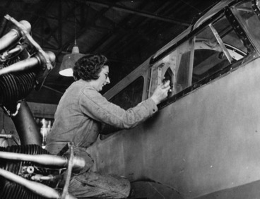 Image: Weigel, William George (Photographer) : Unidentified member of the Women's Auxiliary Air Force repairing a plane at Wigram aerodrome