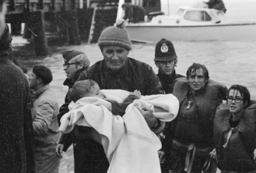 Image: Policeman Ray Ruane holding a young survivor of the Wahine shipwreck