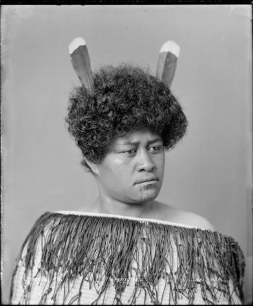 Image: Maori woman wearing korowai and huia feathers