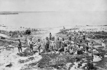 Image: Deveril, Herbert, 1840-1911 :Maori group of men, women and children on the shores of Lake Taupo