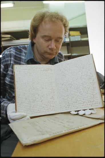 Image: Eamonn Bolger with diary of Treaty of Waitangi witness - Photograph taken by Phil Reid