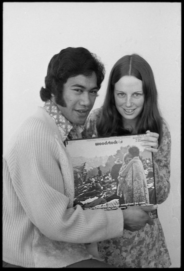 Image: Wellington pop singer Nash Chase and competition winner Pam McLachlan, with with a three record set of the motion picture Woodstock