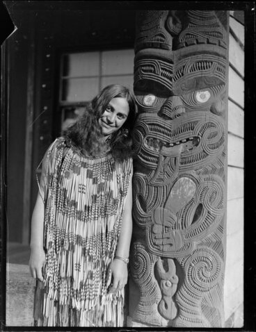 Image: Portrait of Matarita Smallman (nee Pitiroi) of Turangi standing next to an ornately carved amo