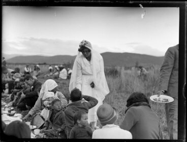 Image: Bride [Ruinea Rota], gives cake to whanau and friends at Korohe marae, Tūrangi