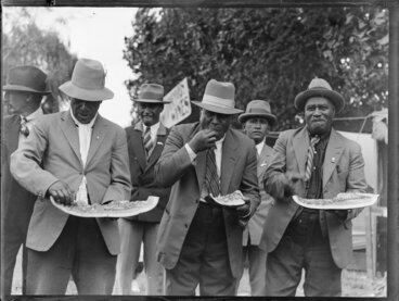 Image: Group of Maori men eating watermelon, location unidentified