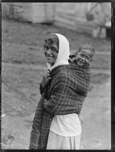 Image: Annie Ngauru Hoko (nee Downs) woman carrying a young child on her back wrapped in a blanket