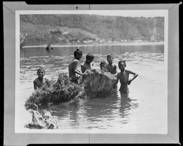 Image: Some Māori boys playing on a tree stump in the river, Lake Taupō