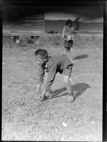Image: Māori boy with a rugby ball, Waikato
