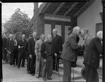 Image: Maori elders welcoming Sir Peter Buck at Marae by giving nose to nose greeting, Ngaruawahia, Waikato