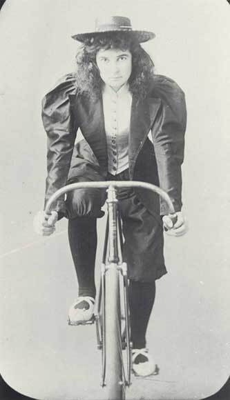 Image: Woman cyclist in knickerbockers
