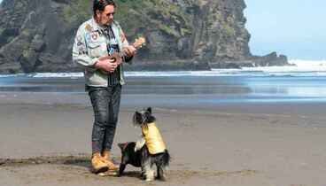 Image: Two dogs, one ukulele, and the extraordinary man who played it