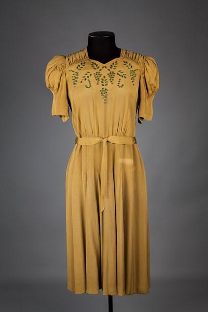 Mustard dress with short leg-of-mutton sleeve