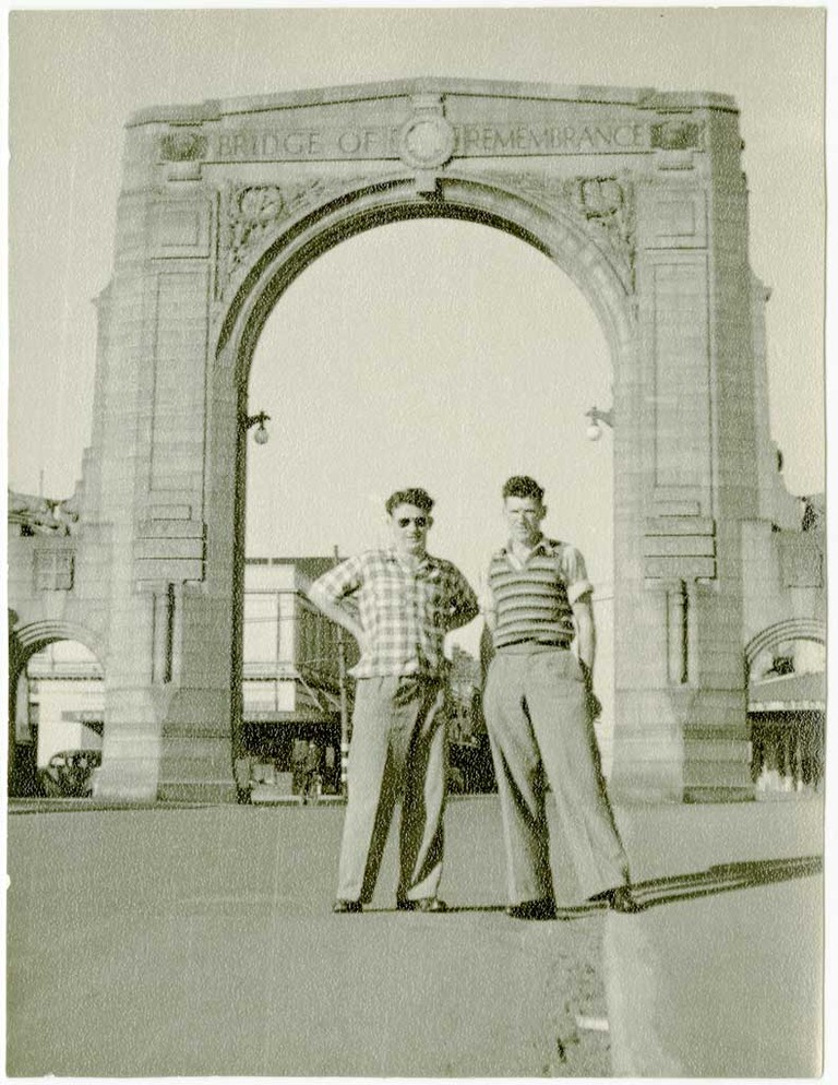 Two brothers, visiting Christchurch, in front of the Bridge of Remembrance, 1950s