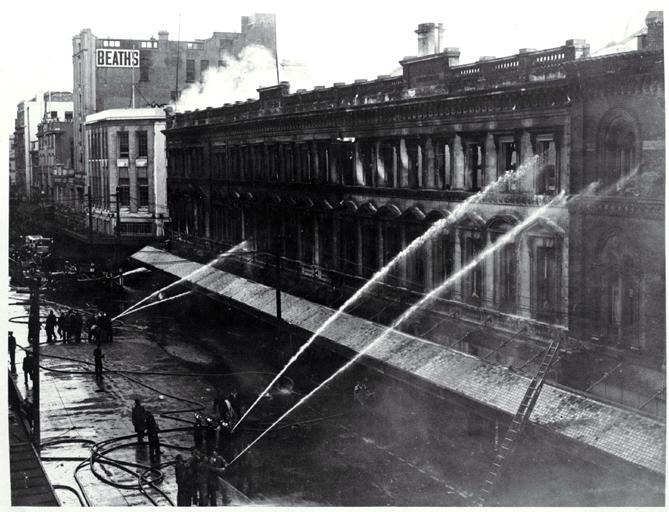 Firemen dampening down Ballantyne's building, Christchurch