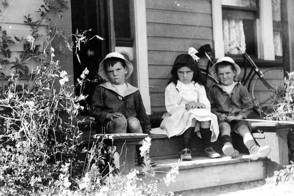 Wilkinson children on verandah of house in Dixon Street